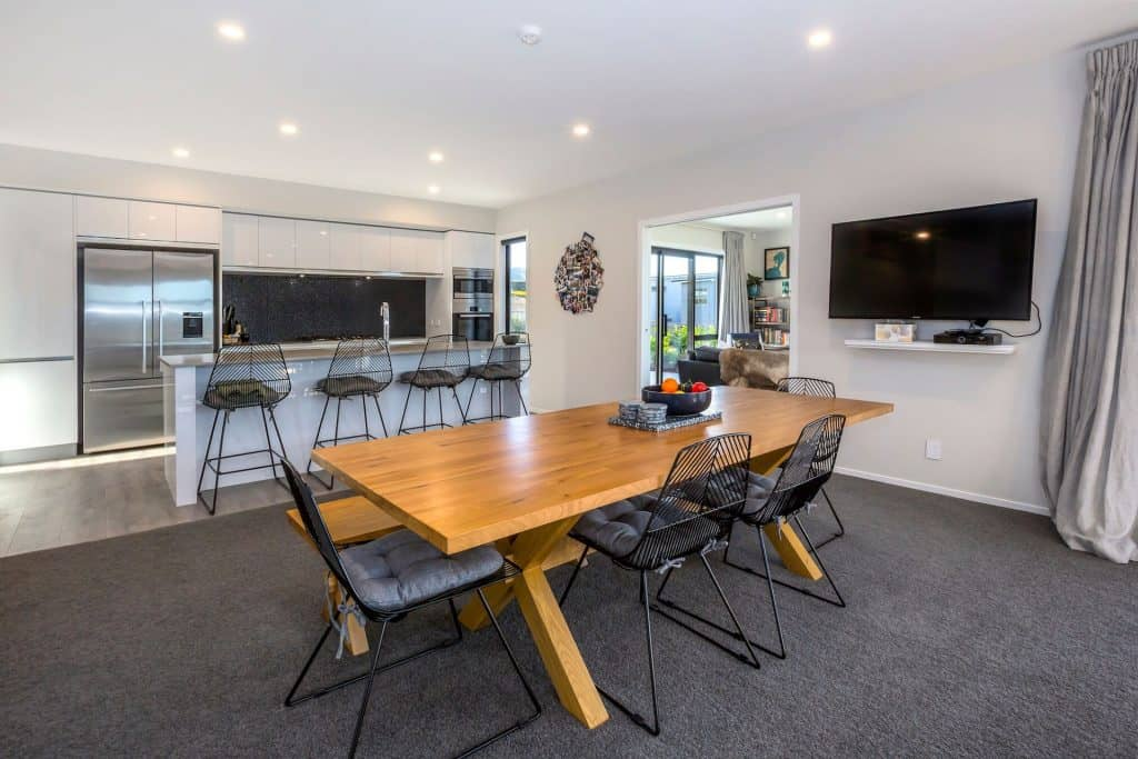 New Home Aotea - White Kitchen With Black Accents